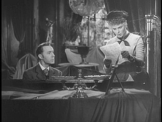 Gaslight (1944 film) - With Gregory looking on, Paula has discovered the letter from Sergius Bauer.