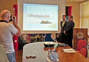 Gibraltarpedia - Gibraltar Minister of Tourism Neil Costa at Government of Gibraltar press conference on Gibraltarpedia, 18 July 2012