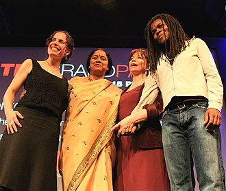 Isabel Allende - Isabel Allende (in red, 3rd L to R), 2007, at TED in California, flanked (L to R) by Susan Cohen, Lakshmi Pratury and Tracy Chapman.