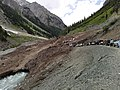Glacial meltwater under road in Ushu Glacier.jpg