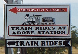 Adobe Mountain Desert Park - Sign leading to the free rides in Adobe Station