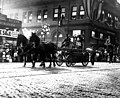 Golden Potlatch Parade, Seattle, showing 1876 fire engine (hose cart with hand pump) (CURTIS 1012).jpeg
