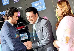 Govinda (actor) - Anil Kapoor, Govinda and his wife at the 2014 IIFA