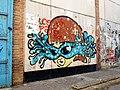 Grafiti de mujer con lentes fashion en Rosario.jpg