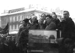 Jacques Sadoul (politician) - The Comintern's 1st Congress. In the car, Grigory Zinoviev and Anatoly Lunacharsky, with foreign delegates—Hugo Eberlein, Otto Grimlund, Fritz Platten, and Karl Steinhardt. Sadoul is the left of the car, in profile, addressing Zinoviev)