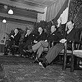 Groep mannen zittend op een podium, waaronder de fabrieksdirecteuren Albert en J, Bestanddeelnr 255-8573.jpg