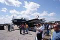 Grumman TBF-1C Avenger FT-28 Taylor LSide crowd TICO 13March2010 (14412783249).jpg