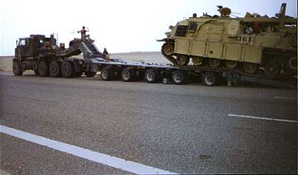 Heavy Equipment Transport System - An M1070 and M1000 loading an M88 Recovery Vehicle in southern Iraq