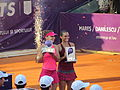 Halep and Vinci with trophies at 2014 Bucharest Open.jpg