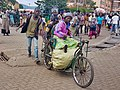 Handicapped-trader-with-assistants-at-Gisenyi-border-to-DRC Peter-Walkenhorst.jpg