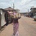 Hawking of local eko akamu at local itoku market.jpg