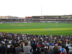 Australian rules football in Tasmania - An AFL match in progress at Aurora Stadium in Launceston between two Melbourne based teams - Hawthorn Hawks and the Western Bulldogs in 2008 attracts a crowd of 19,378 fans.