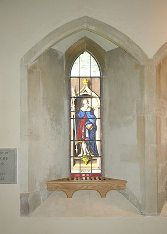 Horspath - Painted glass window in St Giles' parish church presented in 1740 to commemorate the legend that John Copcot used his copy of Aristotle to kill a wild boar in Shotover Forest
