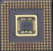 bottom-side view of package of R4700 Orion with the exposed silicon chip, fabricated by IDT, designed by Quantum Effect Devices