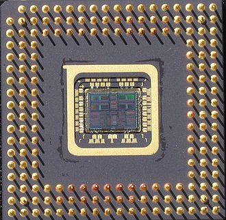 MIPS architecture processors - Bottom-side view of package of R4700 Orion with the exposed silicon chip, fabricated by IDT, designed by Quantum Effect Devices