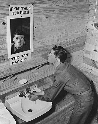 Secrecy - Secrecy is sometimes considered of life or death importance. U.S. soldier at camp during World War II.