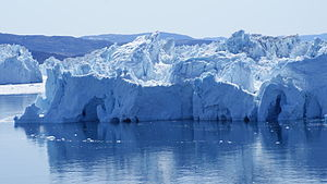 Ilimanaq - Icebergs in the Ilulissat Icefjord with Ilimanaq hills in the background