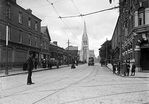 Phibsborough - The Dublin Metropolitan Police on duty with a policeman about to check an approaching car in 1905 in Phibsborough.