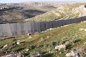 Israeli West-Bank barrier near Ramallah with t...