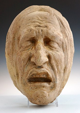 Jean-Joseph Carriès - Stoneware mask with figure in agony or death expression by Jean Carriès.
