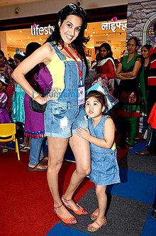 In bigger Indian cities, wearing of shorts by women is generally accepted. Picture shows an Indian woman with her daughter in Mumbai.