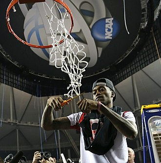 Kevin Ware - Kevin Ware cuts a net after Louisville's victory in the 2013 NCAA championship game.