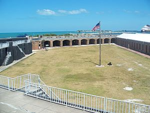 Fort Zachary Taylor Historic State Park - Fort Zachary Taylor Parade Ground as seen from Battery Osceola, with the Civil War barracks on the right, the North Curtain rooms in the background, and Battery Adair on the left.