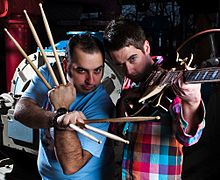 Photograph of two men posing with instruments.