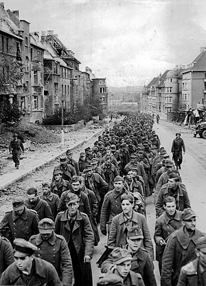 Wehrmacht forces for the Ardennes Offensive - Procession of German prisoners captured after the fall of Aachen.
