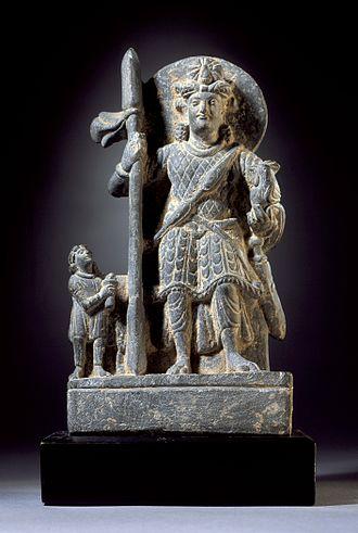 Kartikeya - Kartikeya with a Kushan devotee, 2nd century CE.