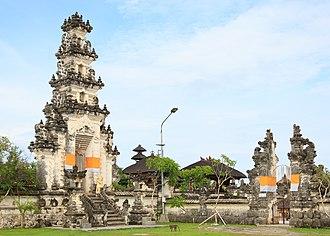 Paduraksa - A paduraksa (left) marks the entrance into the main sanctum of the temple, while the candi bentar (right) marks the entrance into the outer sanctum of the temple.