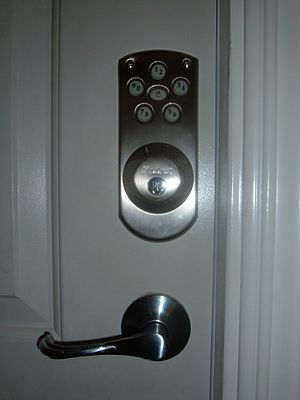 Kwikset - A Kwikset electronic lock with optional operation using conventional key. This electronic deadbolt uses a Weiser keypad and is a hybrid combining features of Kwikset and Weiser brand locks.