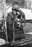 Les Maitres de l'aviation. Mme. la Baronne de Laroche, aviatrice, au poste de direction d'un biplan Voisin. cph.3c07402.jpg