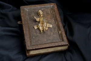 Book of Llandaff - Wooden binding with metal figure