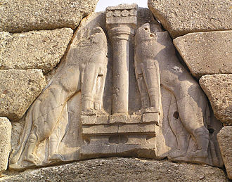 Lion Gate - The confronting lionesses or lions posing on both sides of a pillar above the lintel.