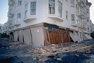 1989 Loma Prieta earthquake - A building in the Marina District at Beach and Divisadero settled onto its buckled garage supports.