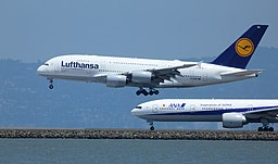Lufthansa Airbus A380 landing at SFO with ANA Boeing 777 on another runway
