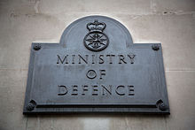 The Ministry of Defence plaque outside the south door of Main Building.