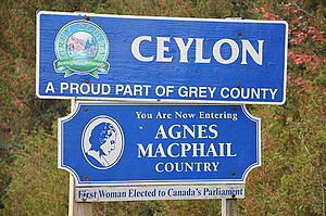 "Agnes Macphail - ""Agnes Macphail Country"" sign at eastern approach to Ceylon, Ontario"