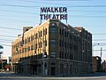 "Flatiron-shaped brick building with ""Walker Theatre"" in large red letters"