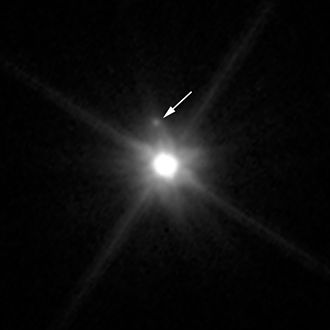 Makemake - Makemake and its moon (indicated by the arrow), as seen by the Hubble Space Telescope