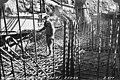 Man standing among reinforcing steel for draft tube on unit no 1, Gorge Dam Powerhouse, February 23, 1923 (SPWS 218).jpg