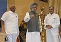 Manmohan Singh lighting the lamp to inaugurate the India Water Week, in New Delhi. The Union Minister for Agriculture and Food Processing Industries.jpg