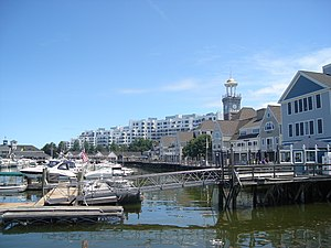 Marina Bay (Quincy, Massachusetts) - Looking east-southeast toward the boardwalk, clock tower and shops at Marina Bay in Quincy, Massachusetts, with the Marina Point condominiums in the background.