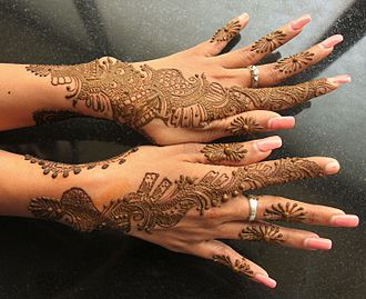 Mehndi - Mehndi applied on the back of both hands.