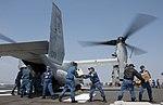 Members of the JMSDF load supplies onto an MV-22B Osprey aircraft. (26268629430).jpg
