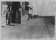 Men on railroad station platform. Hastings, Oklahoma - NARA - 283744.jpg