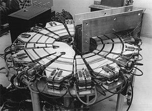 FFAG accelerator - The Michigan Mark I FFAG accelerator.  This 400KeV electron accelerator was the first operational FFAG accelerator.  The large rectangular part on the right is the betatron transformer core.