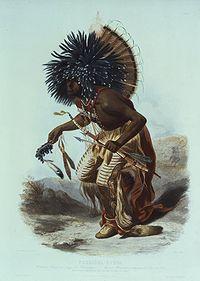 Moennitarri warrior in the costume of the dog danse.jpg