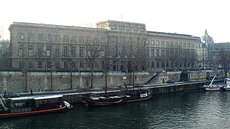 Monnaie de Paris - The full façade of the Monnaie de Paris, seen from Île de la Cité. The dome on the right is that of the Institut de France.